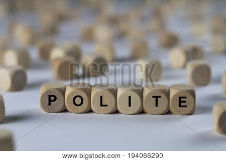 polite - cube with letters sign with wooden cubes stock photo
