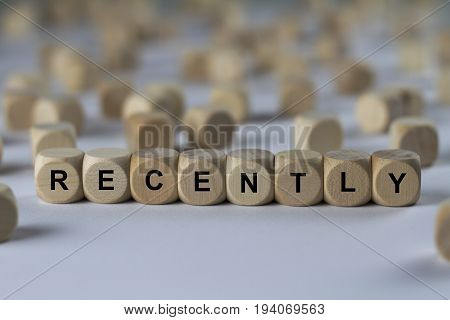 recently - cube with letters sign with wooden cubes stock photo