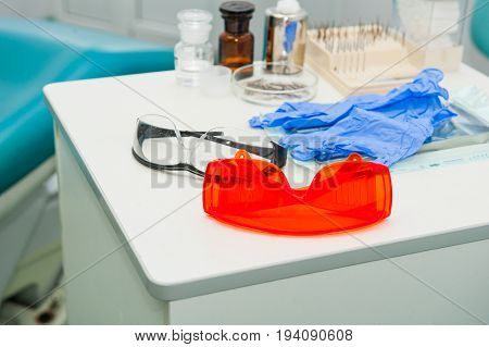 Dental instruments in dentist's office. Dentistry. Dental background: work in clinic - operation, tooth replacement. Selective focus. Space for text. stock photo