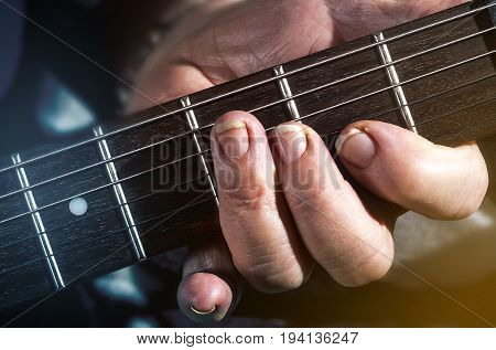old woman man playing electric acoustic guitar black background lifestyle