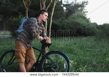 Handsome Young Man Cyclist Standing Resting With Bicycle Near Tree In Summer Park And Resting Recreation Travel Destination Concept