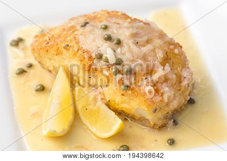 Fresh Ono or Wahoo sauteed in a macadamia nut crust with capers and lemon sauce stock photo