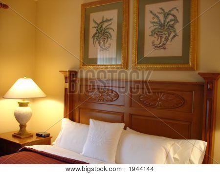 Modern Luxurious Bedroom - dim-lit with plush pillows stock photo