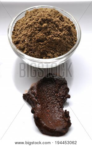 A selection of various natural henna (Lawsonia inermis) hair color dyes wet mixture isolated on white stock photo