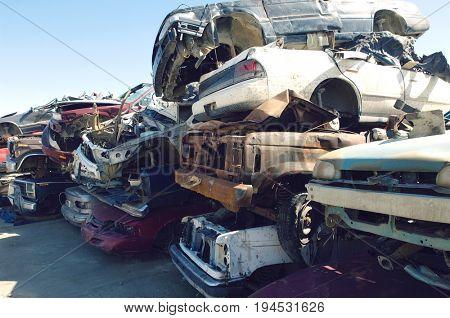Stacked cars in junkyard stock photo