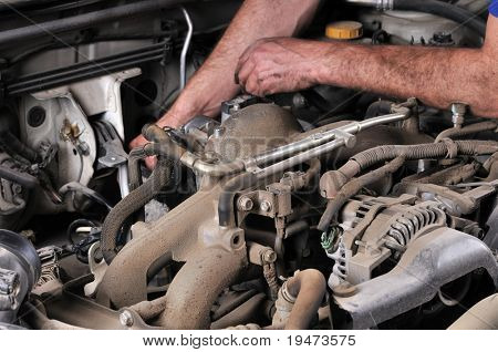 Auto mechanic's hands working on car - a series of MECHANIC related images. stock photo