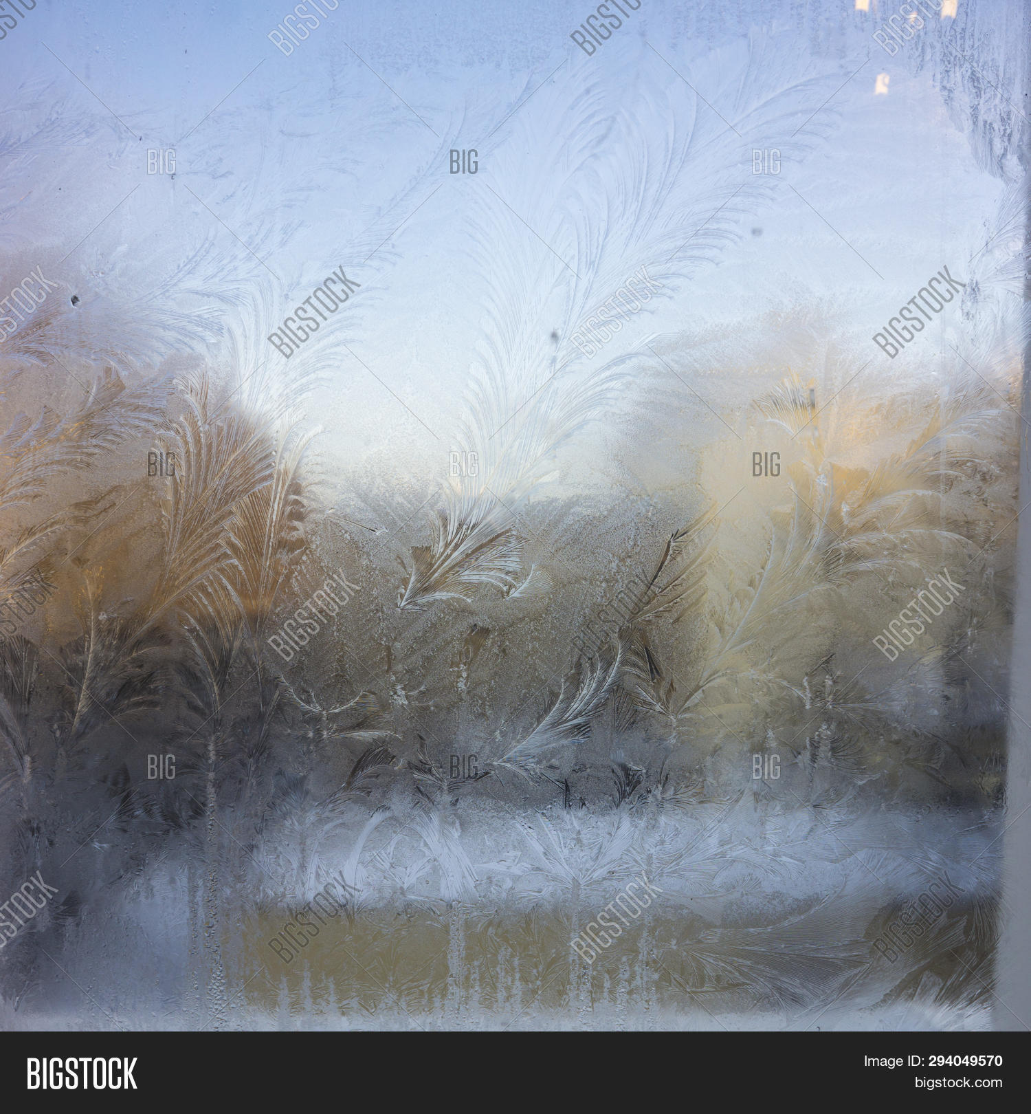 Winter Sunrise In Winter Frozen Window Evening Scene. Frozen Winter Window View. Ice Patterns On Fro