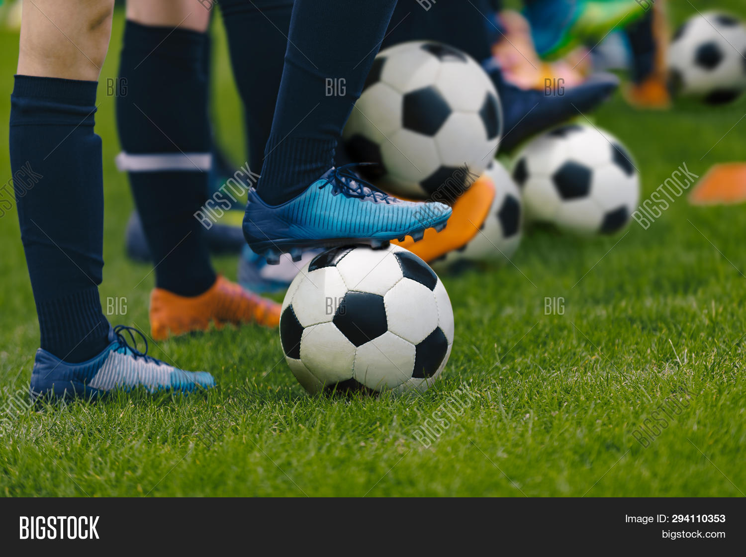 academy,adult,arena,association,athlete,background,ball,boy,camp,caucasian,child,childhood,class,cleats,close-up,coach,coaching,competition,defender,detail,develop,development,education,football,footballer,game,grass,green,kick,kid,match,national,pass,pitch,play,player,run,skill,soccer,sport,sporty,stadium,striker,summer,teaching,team,teenager,training,youth