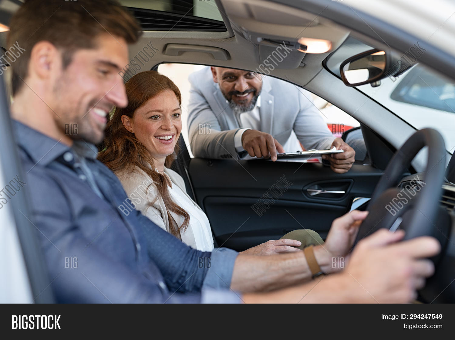 agent,auto,automobile,automotive,buy,car features,car interior,checking,cheerful,choice,choosing,client,comfort,couple,customer,dealer,dealership,drive,feature,hands on steering wheel,happy,holding,interior car,looking,luxury,man,new,purchase,purchasing,sales,salesman,satisfaction,satisfied customer,sell,seller,showroom,sitting,smile,steering wheel,test,test drive,test drive car,transport,try,vehicle,wheel,woman,young couple