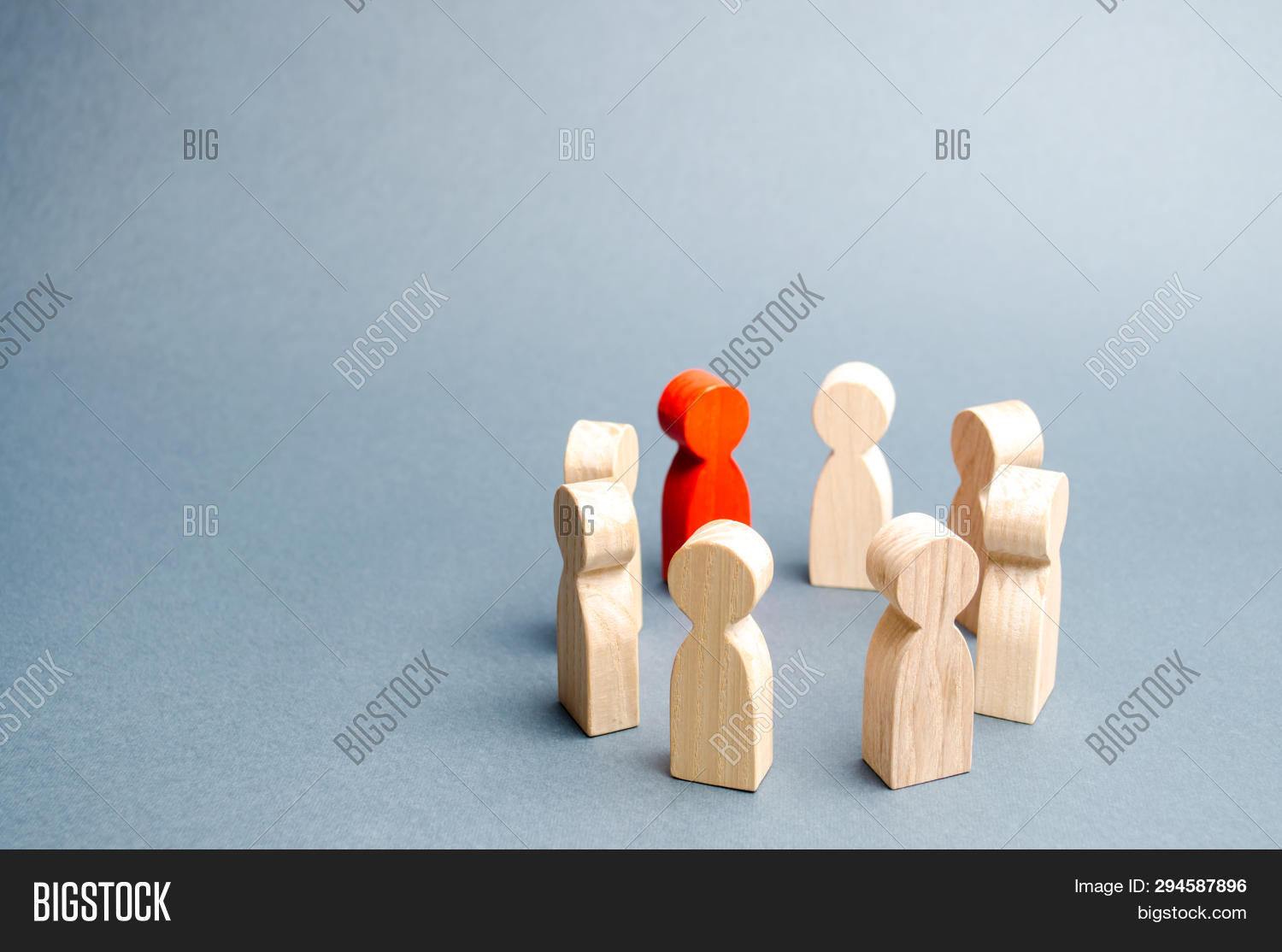 People Stand In A Circle On A Gray Background. Communication. Business Team, Teamwork, Team Spirit.