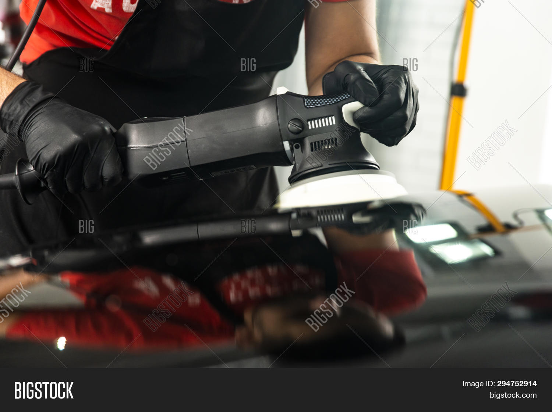 Car Polish Wax Worker Hands Applying Protective Tape Before Polishing. Buffing And Polishing Car. Ca