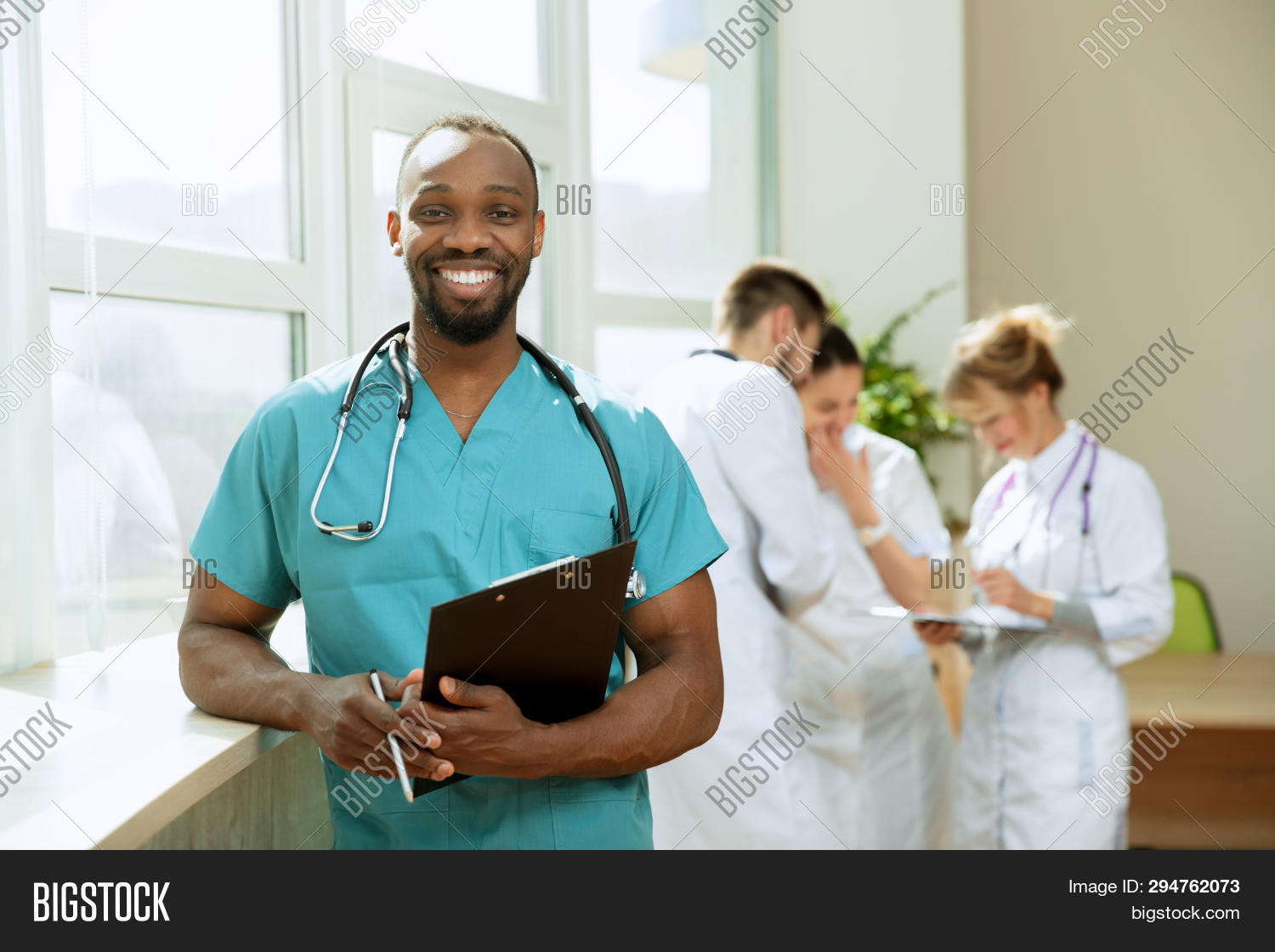 adult,african,attractive,background,banner,care,clinic,clinical,confident,doctors,emotions,female,gp,group,happy,health,healthcare,hospital,job,male,man,medical,medicine,nurses,occupation,people,person,pharmacist,physician,portrait,positive,practitioner,profession,professional,smart,smile,smiling,specialist,staff,stethoscope,surgeon,team,teamwork,uniform,woman,work,workers,young