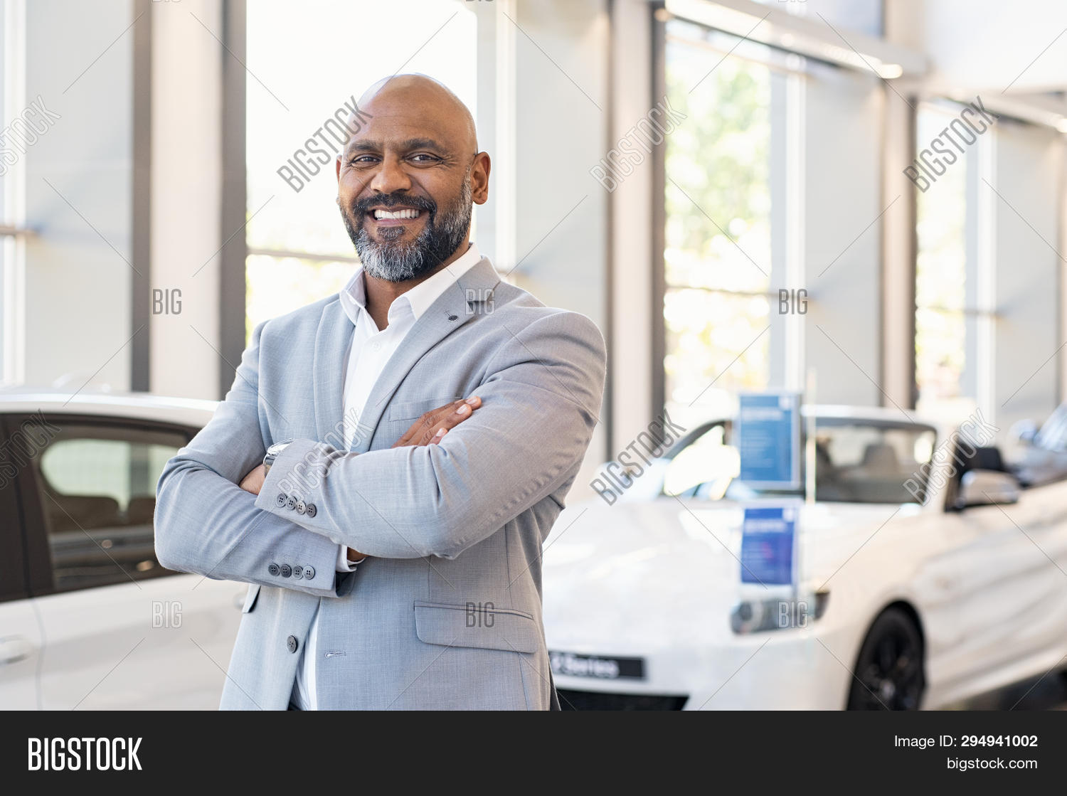 african,african american,african man,agent,agreement,american,auto,automobile,automotive,bearded man,black,business,businessman,car dealer,car dealership,car dealership interior,career,confident,copy space,crossed arms,dealer,dealership,happy,job,looking at camera,luxury,mature,mid adult man,middle aged man,modern,new car,occupation,portrait,professional,proud,rental,sale,salesman,salon,satisfaction,satisfied,seller,selling,service,showroom,smile,successful,toothy smile,transportation,vehicle