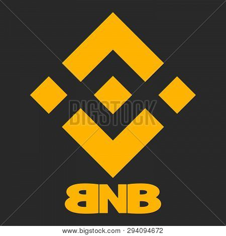 Cryptocurrency Binance Coin - yellow logo on gray background. Stylized abbreviation BNB - cryptocurrency ticker. stock photo