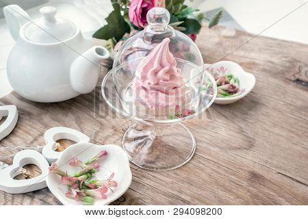 Delicate pink apple marshmallow hand-made in a glass transparent vase. Congratulate. Sign of attention. Marshmallow, dessert. Background stock photo