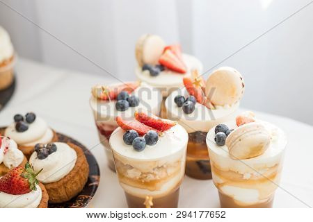 Cake with various berries and meringues on a stand.cakes, dessert with berries, candy bar for party. wedding or happy birthday.Delicious sweets on candy buffet. Lot of colorful desserts on table stock photo