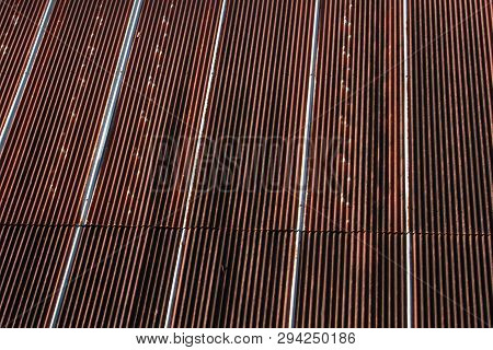 Texture of old zinc surface galvanized rust from the fence next to the house for background, old rusty zinc grunge texture, old zinc surface background The rust on the surface of zinc stock photo