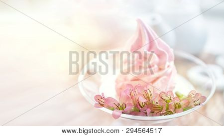 Delicate flowers Kalanchoe on the background Delicate pink apple marshmallow handmade in a glass transparent vase. Marshmallow, dessert. Copy space stock photo
