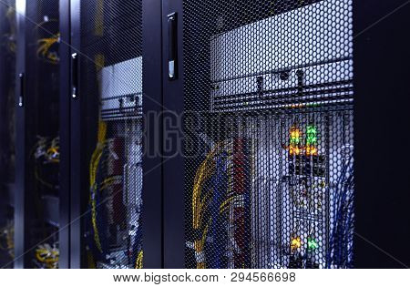 Close up server rack with LED indicator inside under meshed door. Computer server in rack, network and hardware. Inside mainframe. stock photo