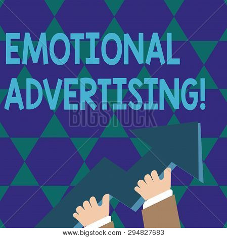 Text sign showing Emotional Advertising. Conceptual photo persuasion method used to create emotional feedback photo of Hand Holding Colorful Huge 3D Arrow Pointing and Going Up. stock photo
