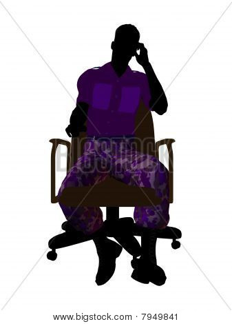 Male soldier sitting on an office chair silhouette on a white background stock photo
