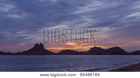 Twin peaks of Mount Tetakawi silhouetted against a glorious sunset stock photo