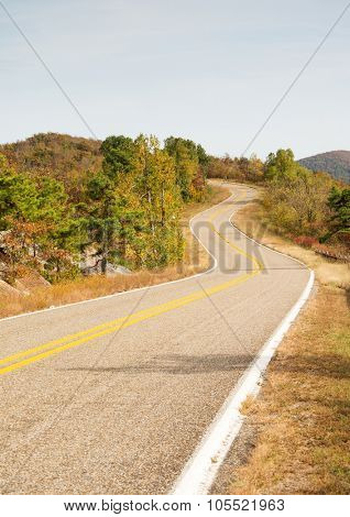 Talimena scenic byway winding on the crest of the mountain, with trees in fall colors stock photo