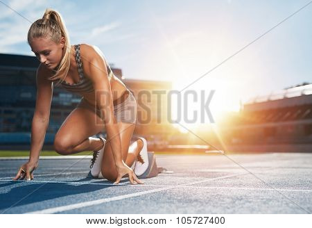 Female Sprinter In Track Starting Blocks