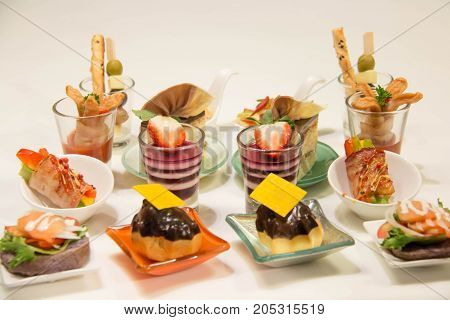 Delicious assorted mini food standing cocktai banquet stock photo