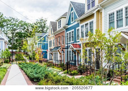 Row Of Colorful, Red, Yellow, Blue, White, Green Painted Residential Townhouses, Homes, Houses With