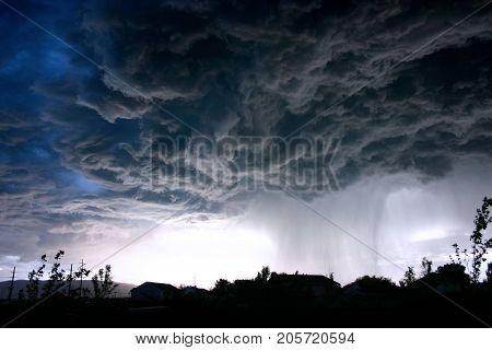 A heavy rain cloud over the sea.