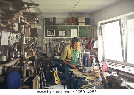 Lutist shaping a violin  stock photo