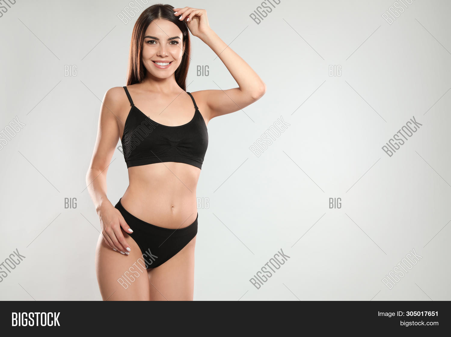 Portrait Of Attractive Young Woman With Slim Body In Swimwear On White Background. Space For Text