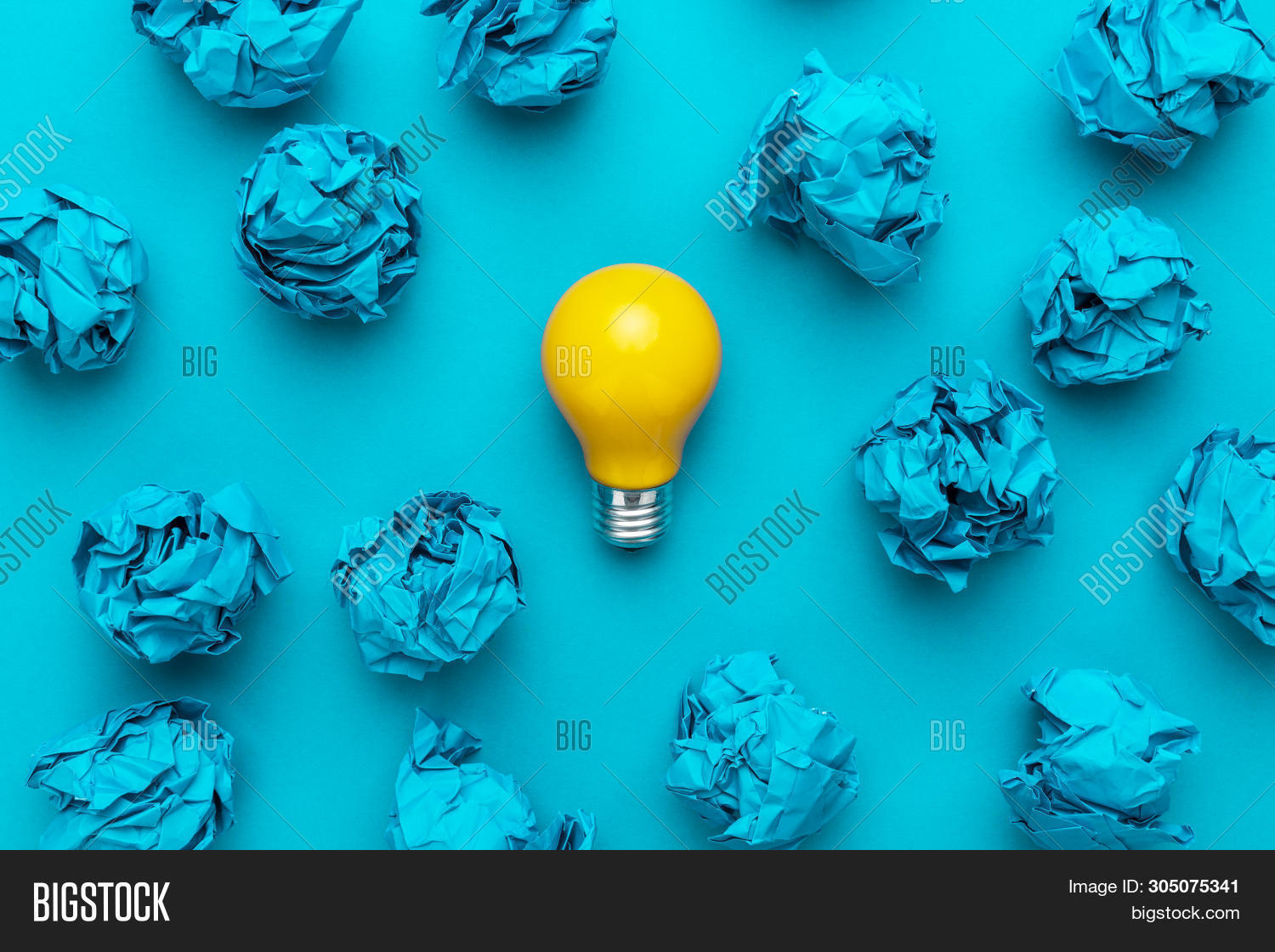 New Idea Concept With Blue Crumpled Office Paper And Light Bulb. Top View Of Business Idea Concept O
