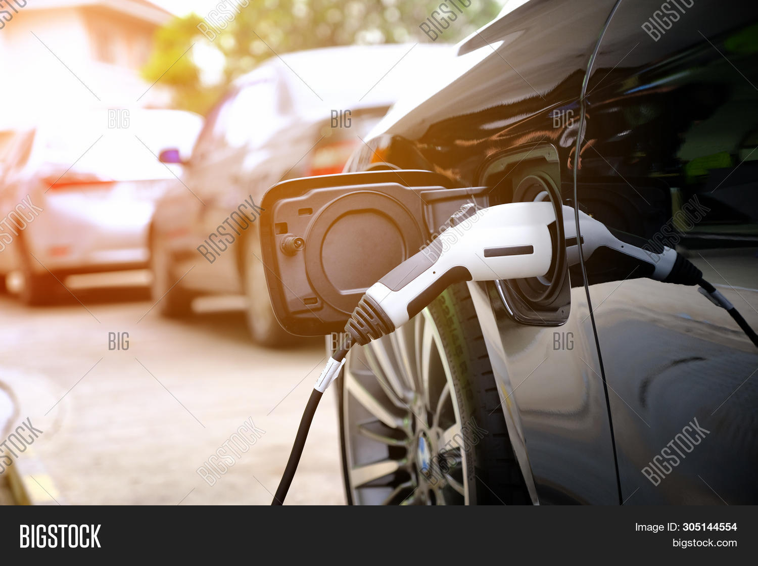 Charging Modern Electric Car Battery On The Street Which Are The Future Of The Automobile, Close Up