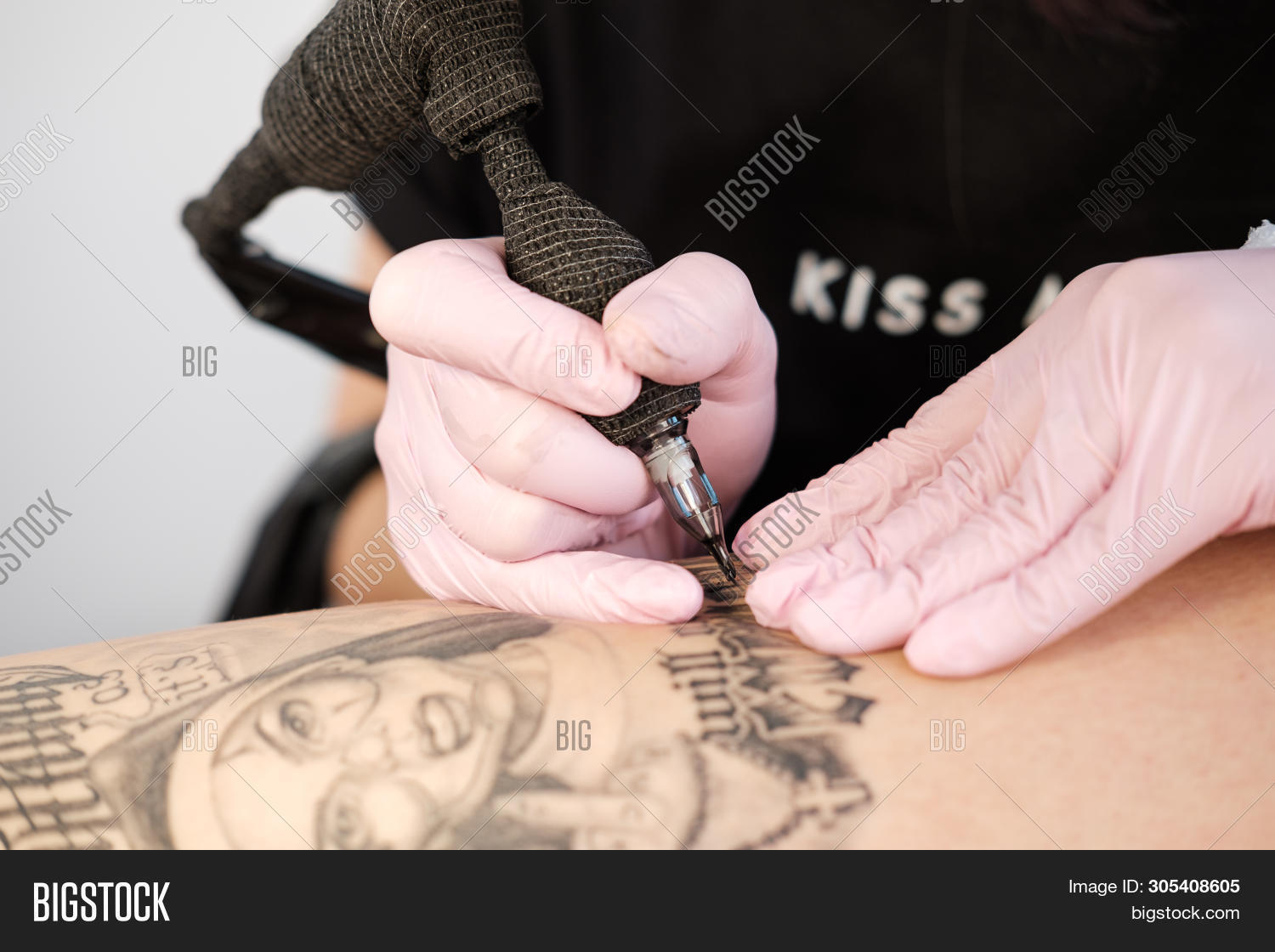 adult,alternative,art,artist,artwork,attractive,background,black,body,caucasian,closeup,creative,design,drawing,dreadlocks,equipment,fashion,female,girl,gloves,hand,handsome,haunch,hip,individual,individuality,ink,machine,makes,man,master,nun,pain,paint,pattern,people,pigment,professional,salon,skin,studio,style,tattoo,tattooer,tattooing,tattooist,technician,tool,woman,young