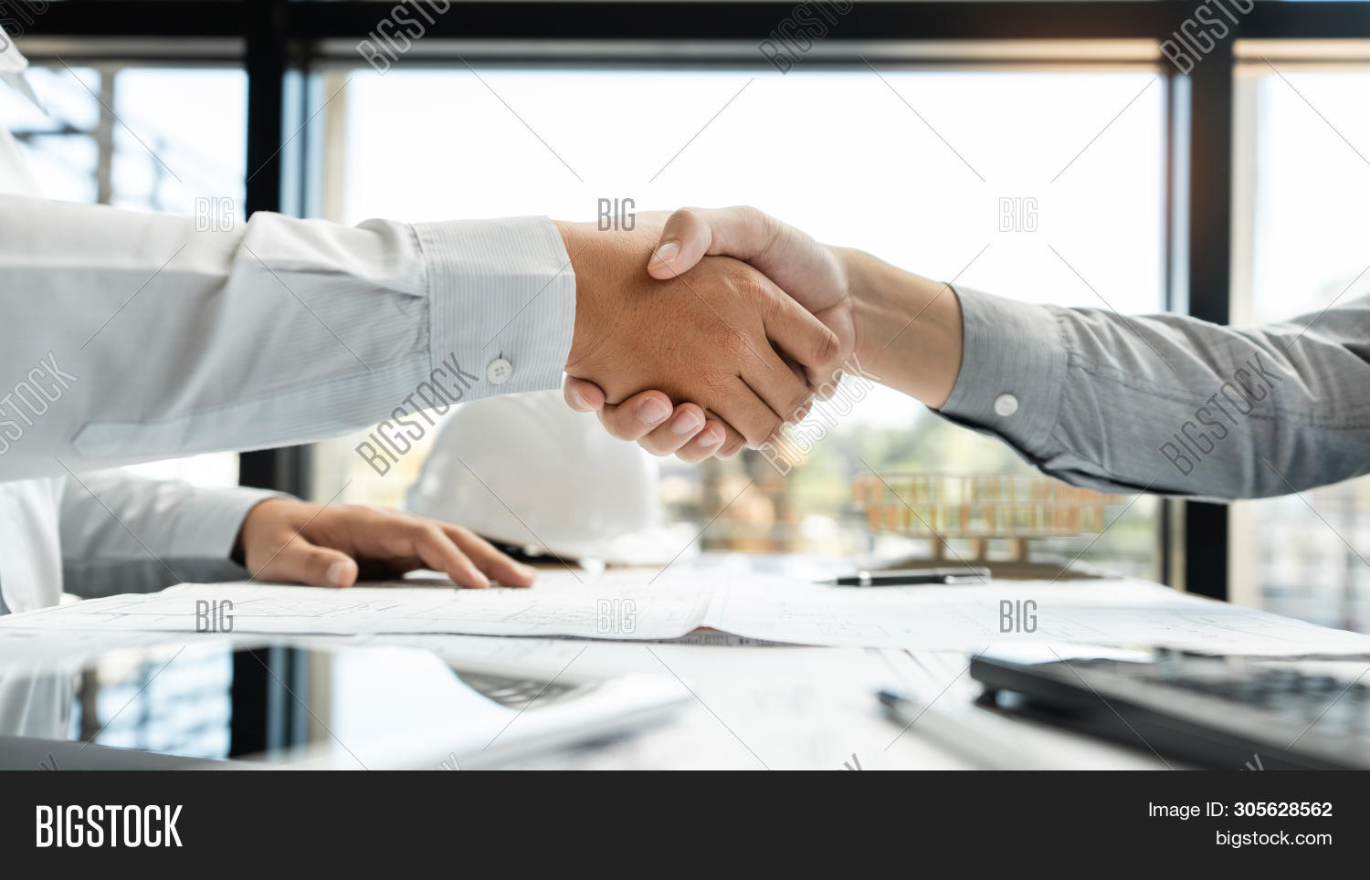 agreement,architect,architecture,blueprint,builder,building,business,businessman,concept,construction,contractor,cooperation,deal,engineer,factory,foreman,gesture,greeting,hand,handshake,hardhat,helmet,house,industrial,industry,investment,job,join,male,man,manager,meeting,occupation,partner,partnership,people,person,professional,project,real,safety,shake,site,success,successful,team,teamwork,together,work,worker