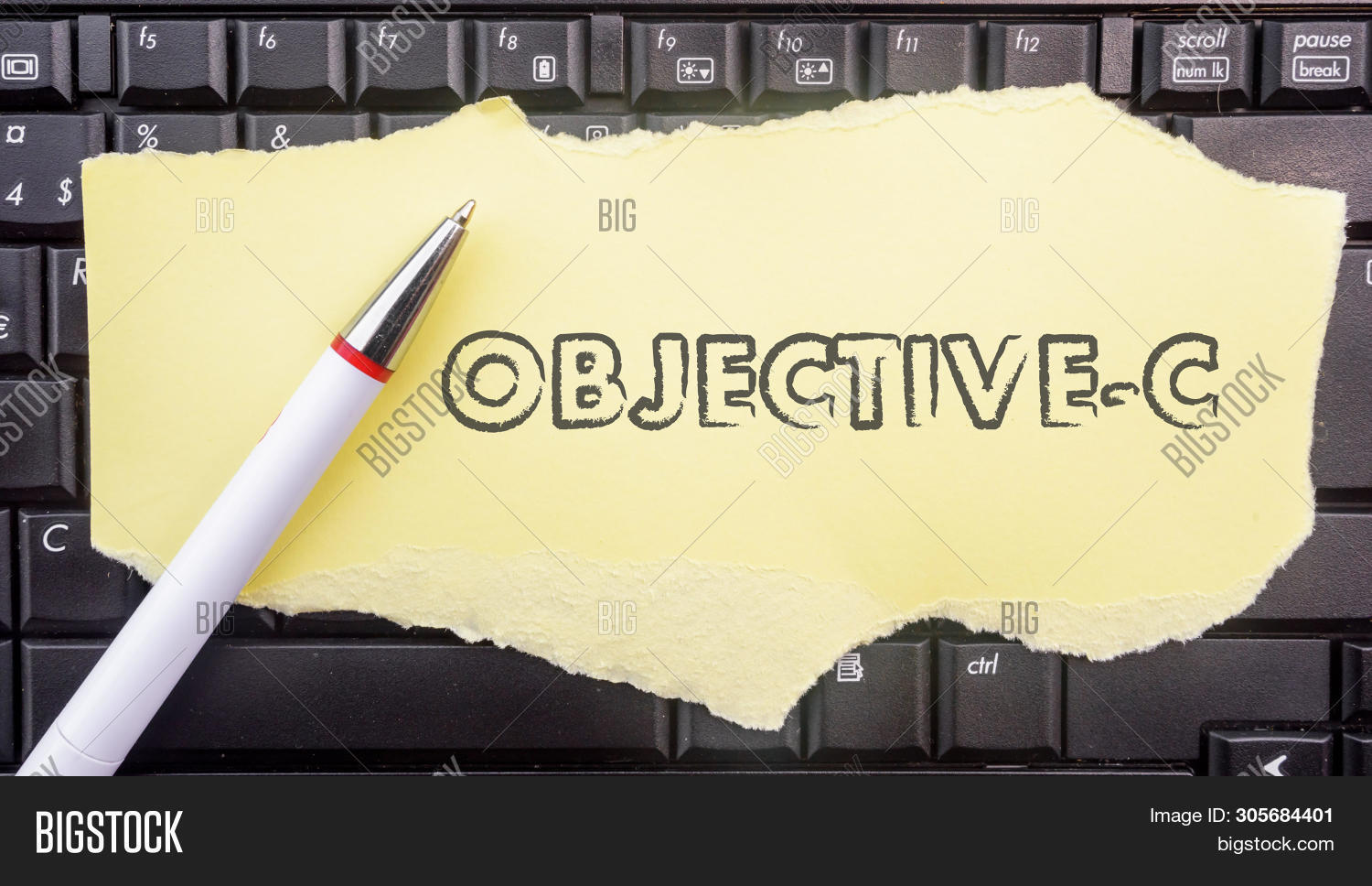 Objective-c Programming Language. Paper Width Word Objective-c And Pencil On Laptop Keyboard