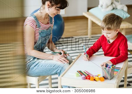 In therapy, kid is learning skills that don't come naturally because of ADHD, like listening and paying attention better stock photo