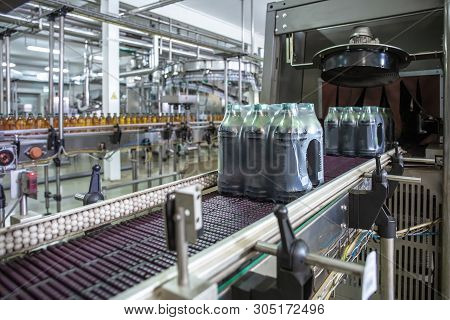 Industrial Machine For Packaging Of Beverage Plastic Bottles At Plant For Production Of Beverages, J