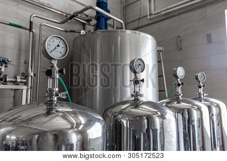 Manometers On Steel Cylinder Storages Or Vats Or Tanks On Production Plant, Industry Equipment.