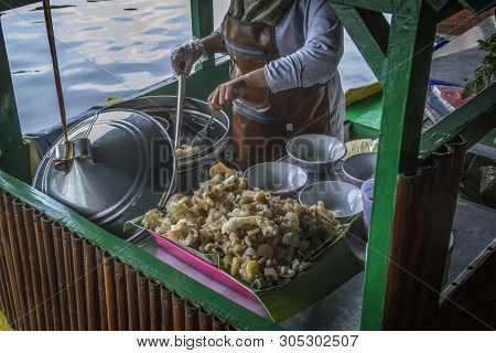 Beef broth flavoured noodles dishes soup at a busy street food market stock photo