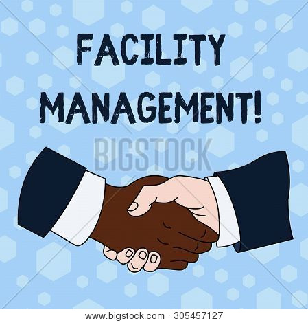 Word writing text Facility Management. Business concept for Multiple Function Discipline Environmental Maintenance Hand Shake Multiracial Male Business Partners Colleagues Formal Shirt Suit. stock photo