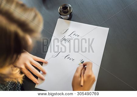 I Love You. Calligrapher Young Woman Writes Phrase On White Paper. Inscribing Ornamental Decorated L