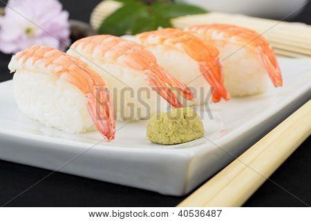 Ebi Niguiri Sushi - Japanese prawn nigiri sushi on a white platter served with wasabi. stock photo