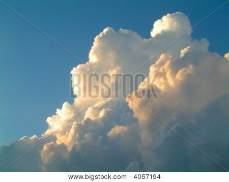 cumulus clouds before a heavy tropical rain storm in Thailand stock photo