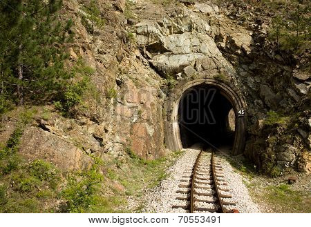 Small tunnel with railway for old train called Shargans Eight on Mokra Gora in Serbia ** Note: Shallow depth of field stock photo