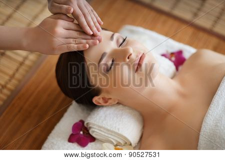 Young, beautiful and healthy woman in spa salon. Traditional oriental massage therapy and beauty tre