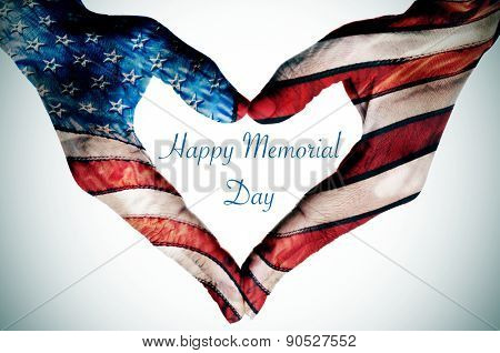 the text happy memorial day written in the blank space of a heart sign made with the hands of a woma