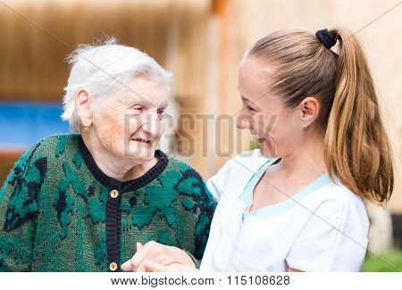 Photo of elderly woman with her caregiver stock photo